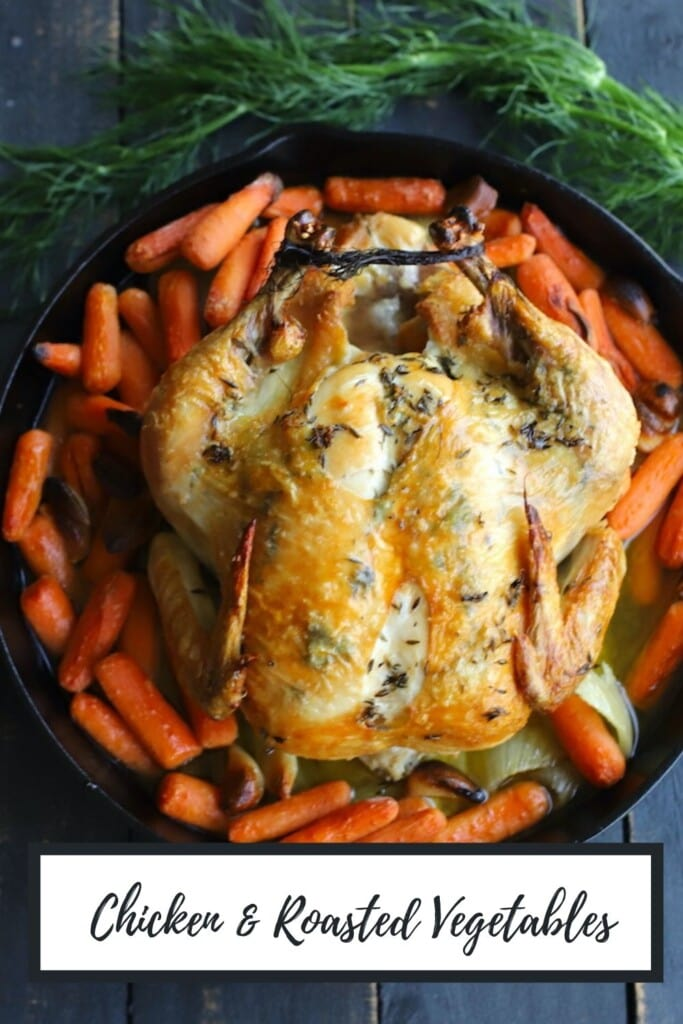 chicken and vegetables in a cast iron skillet