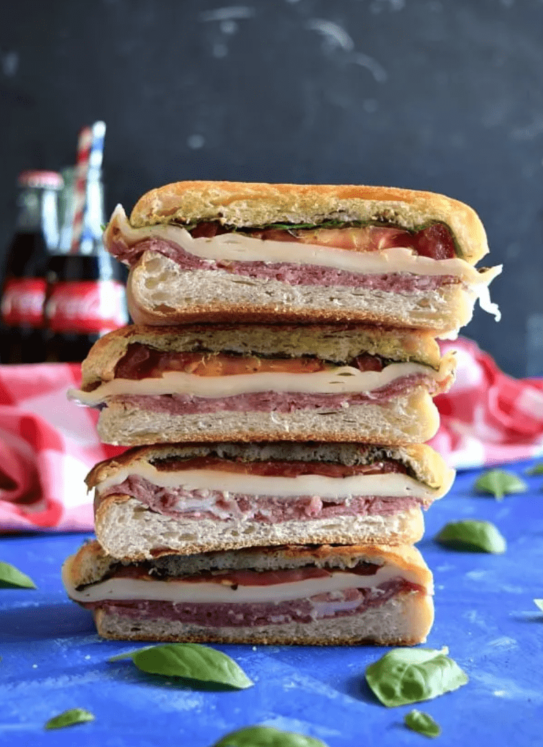 stacks of sandwiches on a blue background