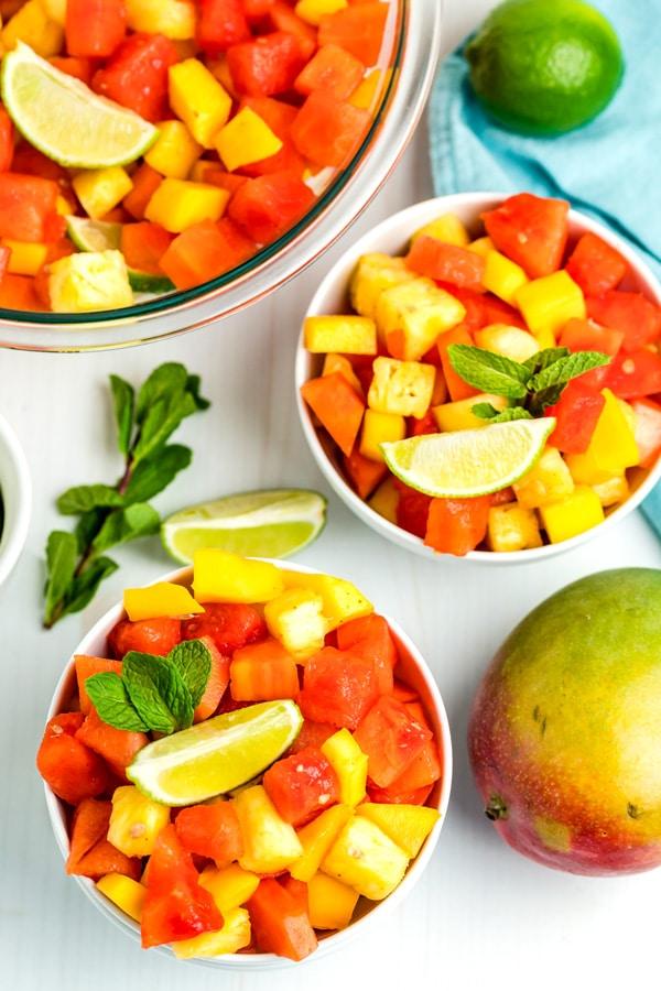 fruit salad in white bowls