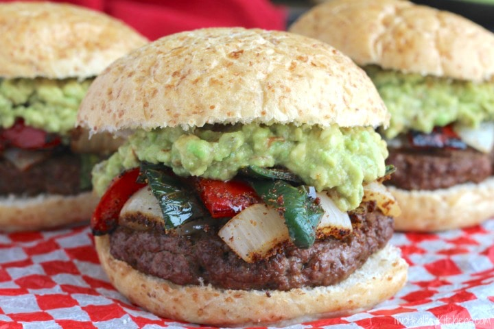 burger with red and green peppers, onions, and guacomole