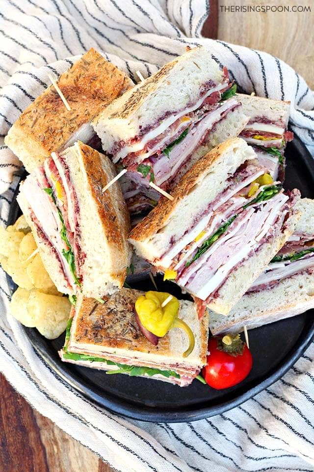 plate of pressed Italian sandwiches