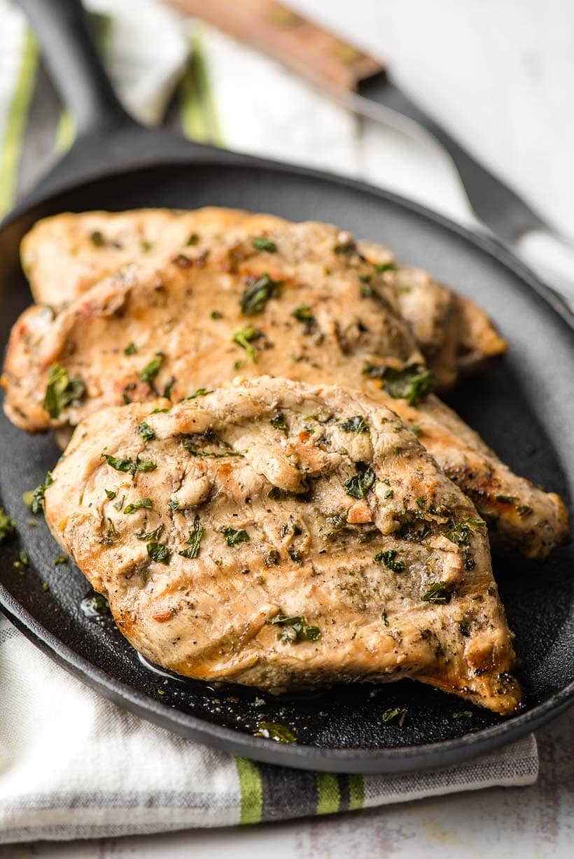 grilled chicken on black plate