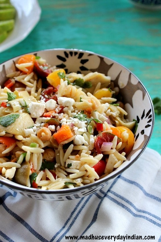 orzo, feta, tomatoes, in a flower bowl