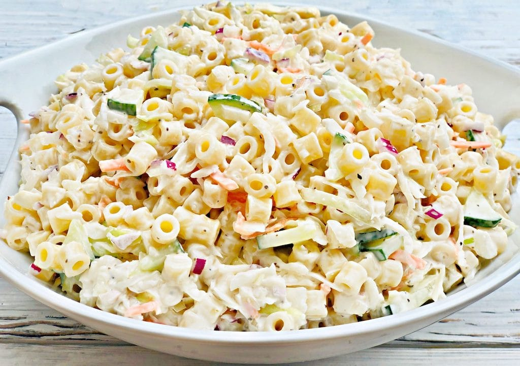 pasta and cabbage slaw in white bowl