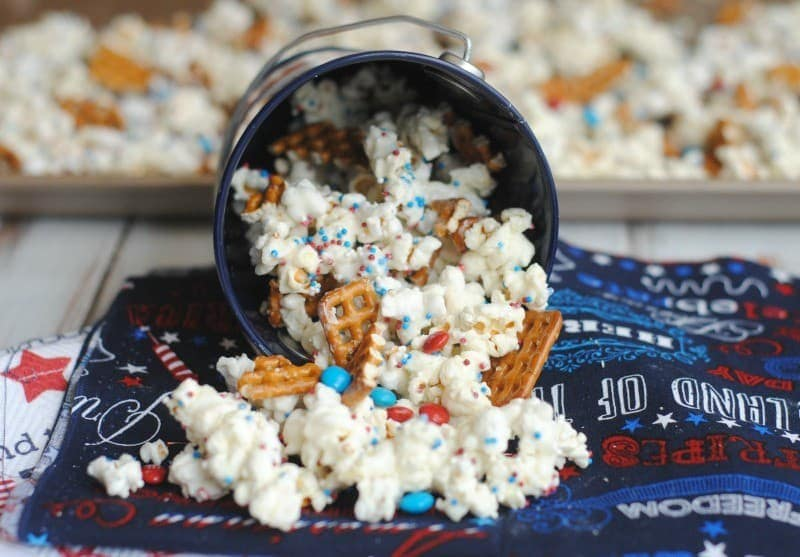 festive popcorn in a can spilled over