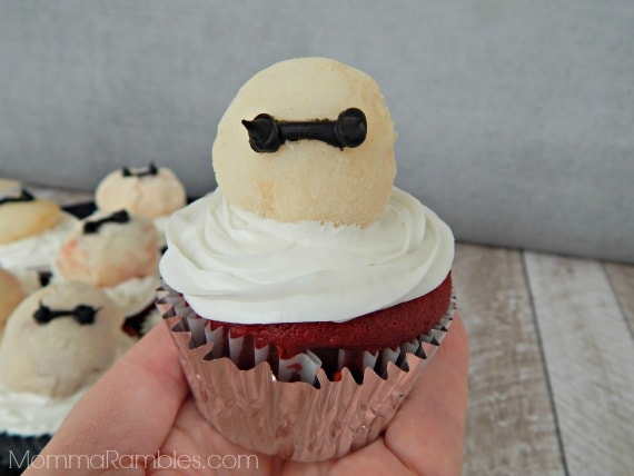 cupcakes tipped with Baymax from Big Hero 6