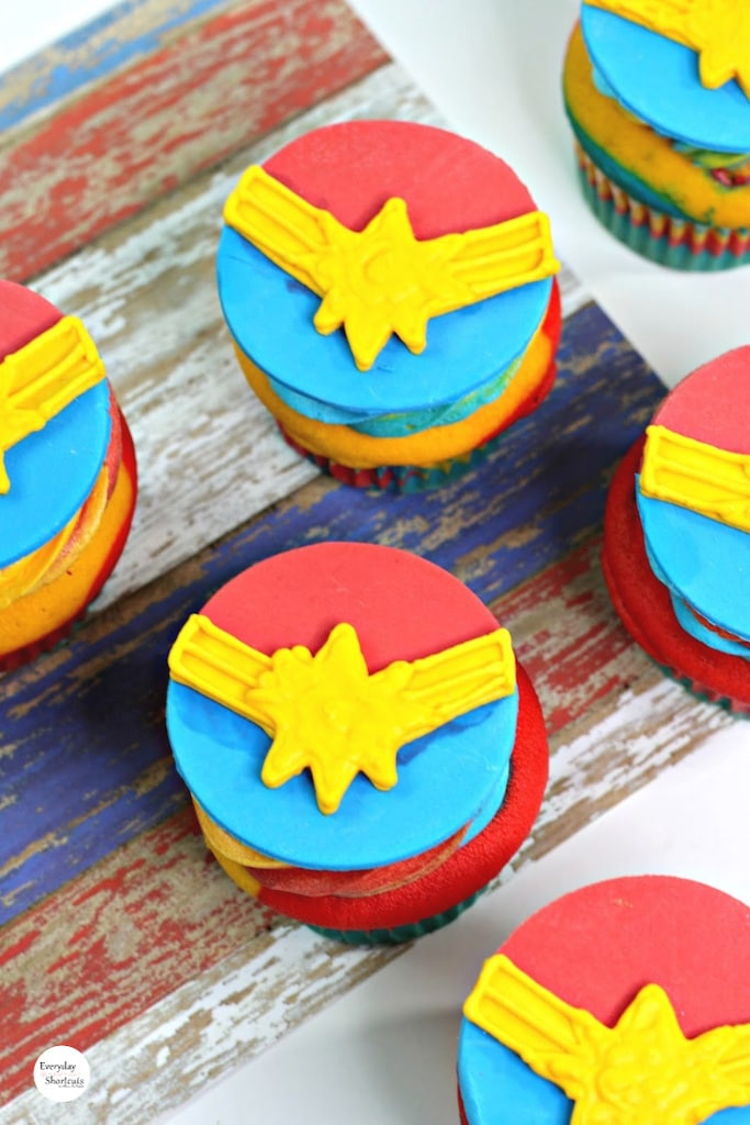 red, yellow, blue cupcakes with star