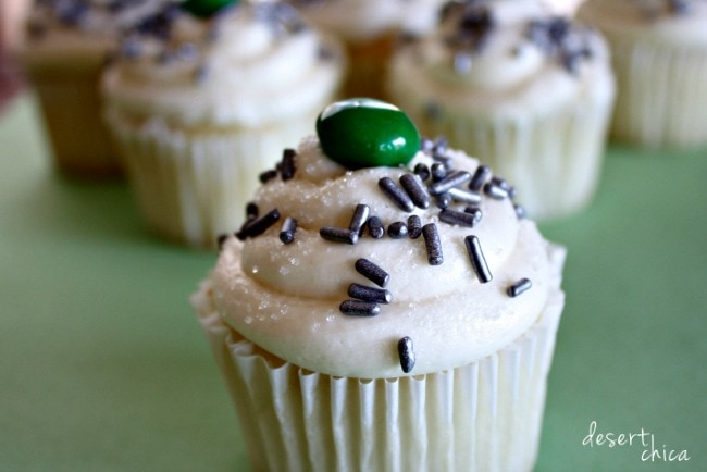cupcakes with chocolate sprinkles and green candy on top