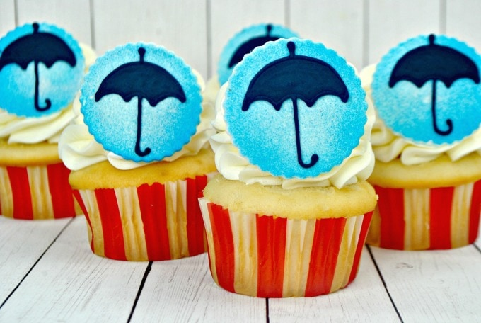 cupcakes topped with umbrellas