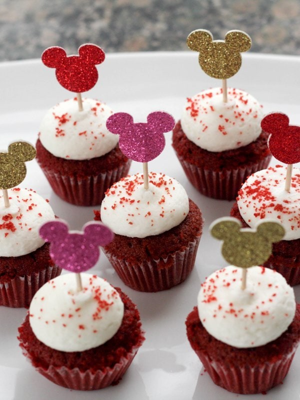 red cupcakes with white icing and Mickey Mouse toppers
