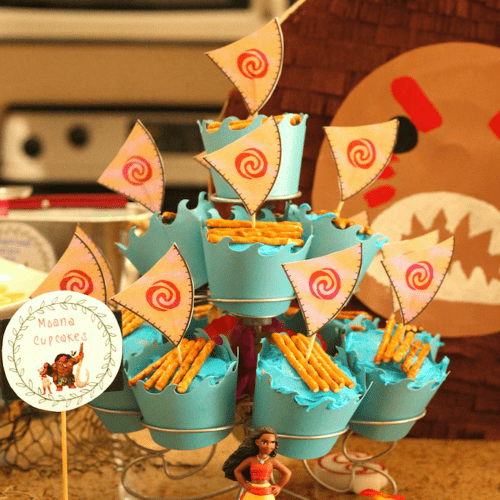 Cupcakes with blue icing, pretzels, and sails
