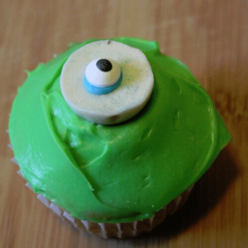 green cupcake with eyeball candy on top