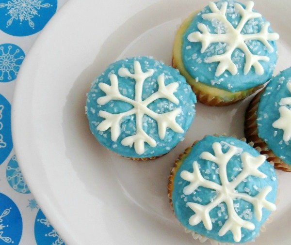 Light blue frosted cupcakes with white snowflake
