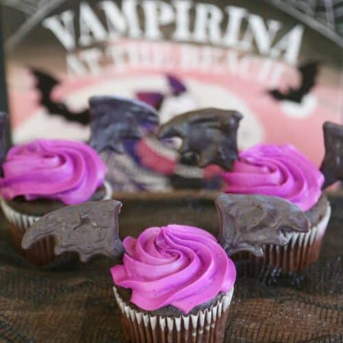 Bat wing cupcakes with purple icing.