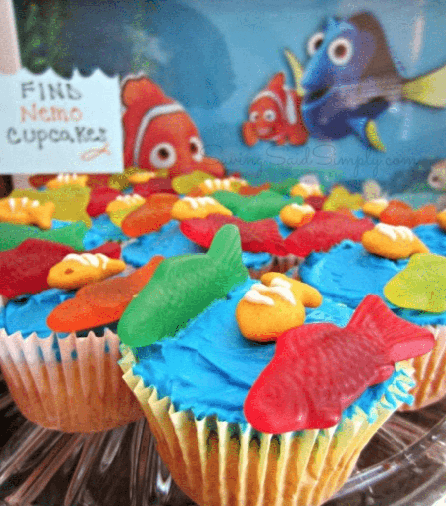 blue cupcakes with red and green fish on top