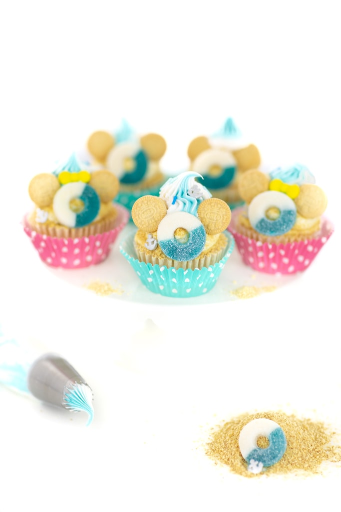 vanilla cupcakes with lifesavers and cookies on top