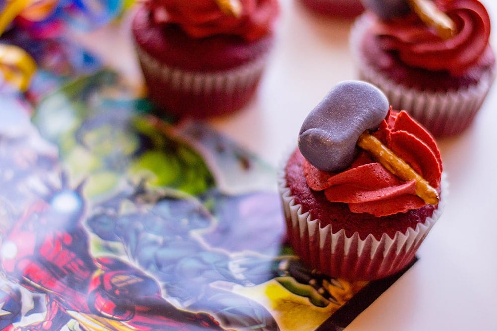 Thor cupcakes with red icing and a purple hammer