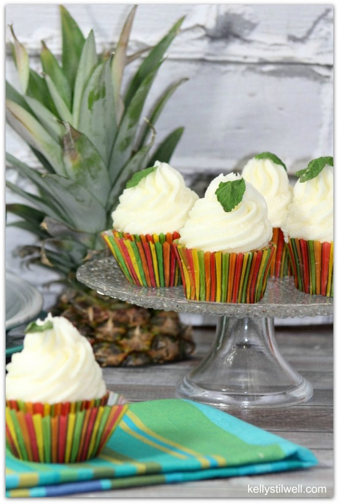 These pineapple mojito cupcakes are the perfect dessert for your next party! Can you imagine walking in to a party with this dessert? Everyone will forget the rest of the food!