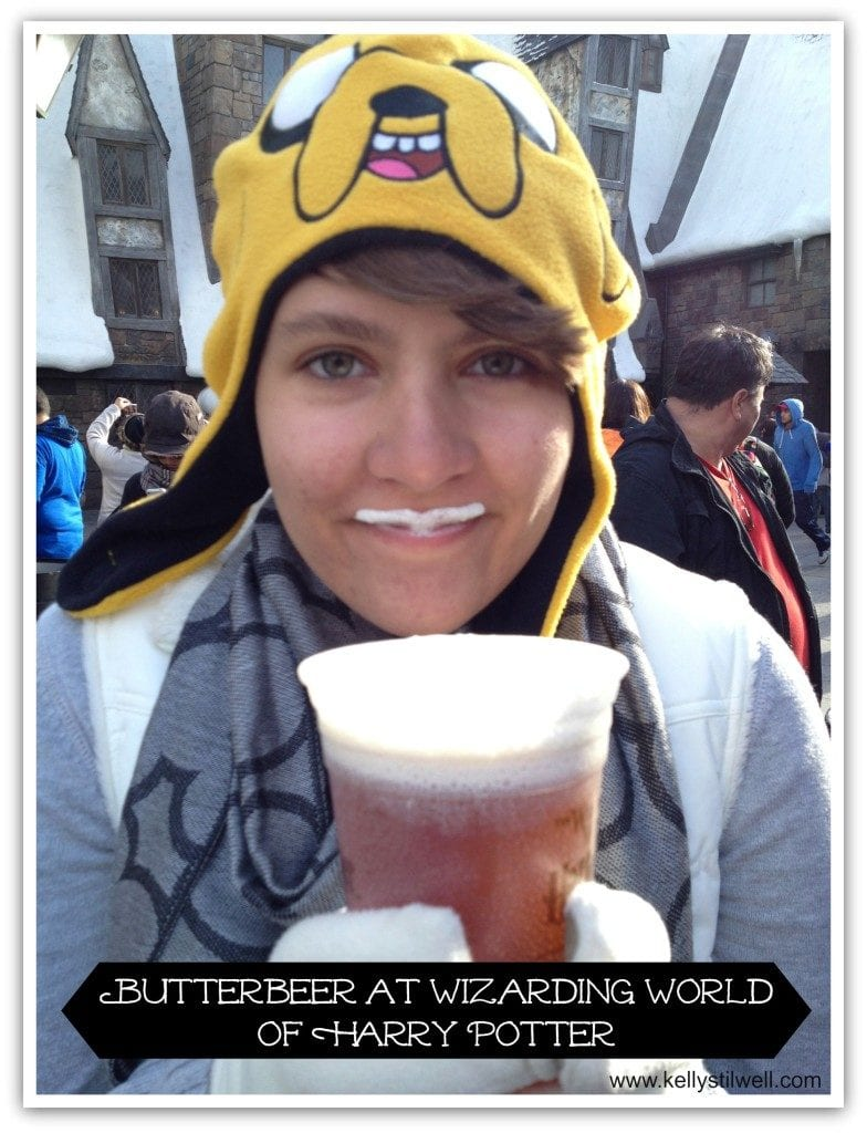 Girl drinking butter beer at Harry Potter World.