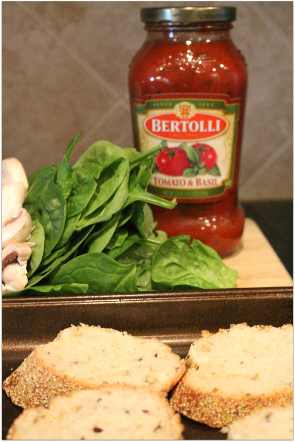 These Bruschetta Melts are bursting with flavor! Topped with tomato sauce, fresh spinach, mushrooms, and fresh mozzarella, this is the perfect appetizer to take when bringing food to a party. The recipe is simple and easy. We had it for dinner with a salad. It's one of my favorite recipes!