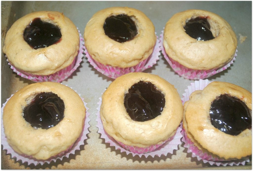 These peanut butter and jelly cupcakes are so delicious! They remind me of my childhood! They make a perfect dessert or treat for any gathering. The next time you have to bring food to an event, head to the kitchen and whip these up! Everyone will love them!