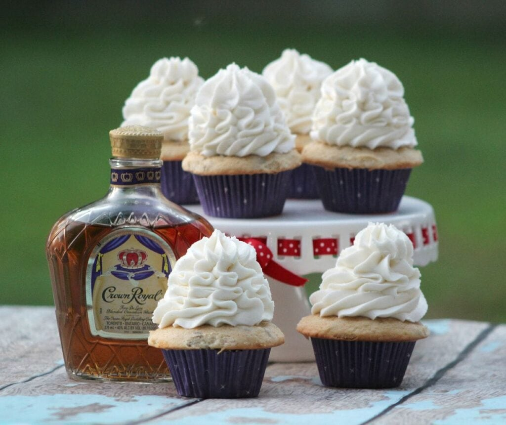 These delicious Crown Royal Butter Pecan Cupcakes are the perfect dessert for your adult party! The flavor of the Crown Royal is subtle, with a hint of vanilla and fruit. The next time you need a recipe for something special to bring to a party, try this amazing sweet treat!