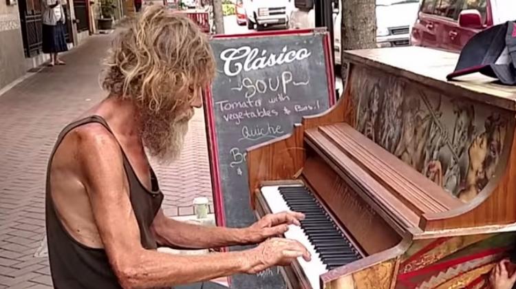 homeless man plays piano