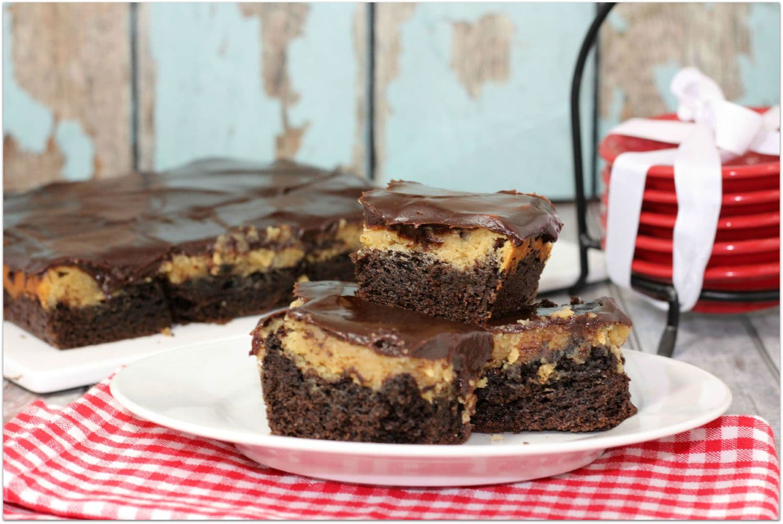 These Peanut Butter Chocolate Ooey Gooey Bars are so delicious, your family is going to ask for this recipe over and over again! Any dessert recipe with peanut butter and chocolate is a hit with my family! Can you imagine these warm with ice cream? It's the perfect after dinner dessert or after school treat!