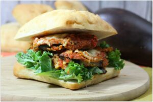 This eggplant parmesan panini recipe is perfect for an easy weeknight dinner! During the busy school year, I look for recipes that I can ship up easily and won't keep me in the kitchen all night. This makes a delicious easy dinner and is vegetarian, so great for cutting out meat a couple of times per week.