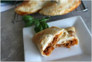 This Mini sausage calzone recipe is so easy, and my kids raved over how delicious they were! These would make a great lunch, dinner, and perfect appetizers for a party. I love easy recipes!