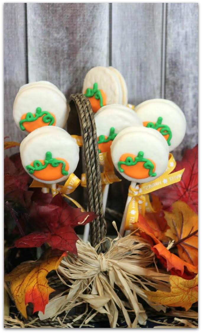 You've probably seen those adorable little dessert pops you can get in your favorite coffee shop or bakery that sell for a couple of dollars each. These Pumpkin Oreo Pops are such an easy dessert recipe, you can totally DIY! Get the kids in the kitchen with you to help make these delicious cookie pops on a stick! These directions can be used for all kinds of holiday recipes, but this one is perfect for Halloween and all the way through Thanksgiving! They are also a fabulous gift idea!
