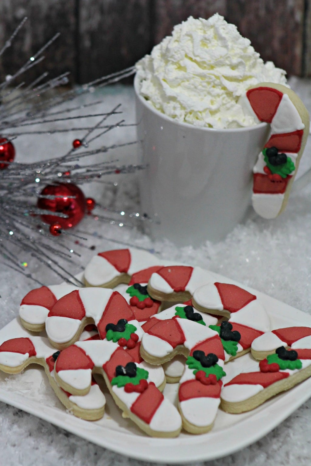 These Hidden Mickey Candy Cane Cookies are the perfect dessert for Disney fans! Need a dessert for school? Your child's classmates will love seeing these delivered to their class party!