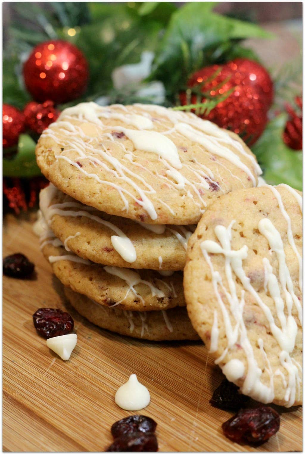 This recipe for Cranberry Cookies with White Chocolate Drizzle is such a great treat for Christmas because it's a little bit different. Cranberries and white chocolate go so well together! I have dozens of recipes for Christmas desserts, but this is one of my favorites. When you are asked to bring food to a party, this will be a huge hit! It even makes a great gift idea! I love DIY gifts of desserts because they are personal and save me money!