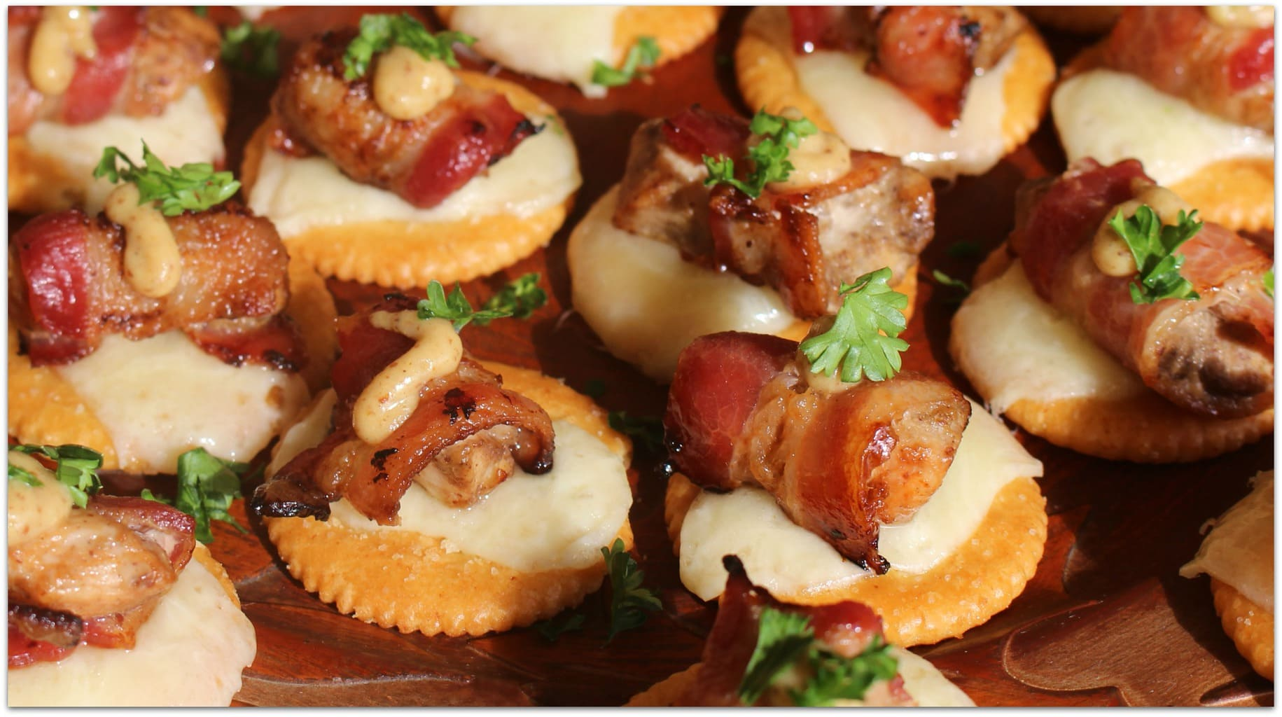Appetizers are my favorite food! I love going to a party and trying every appetizer! In fact, we often order nothing but appetizers when we go out, and I'll even serve a few appetizers for an easy dinner. This is one of my family's favorite chicken recipes, probably because it included bacon! The next time you have to bring food to a party, head the the kitchen and make these delicious Bacon-Wrapped Chicken bites on Ritz Crackers.