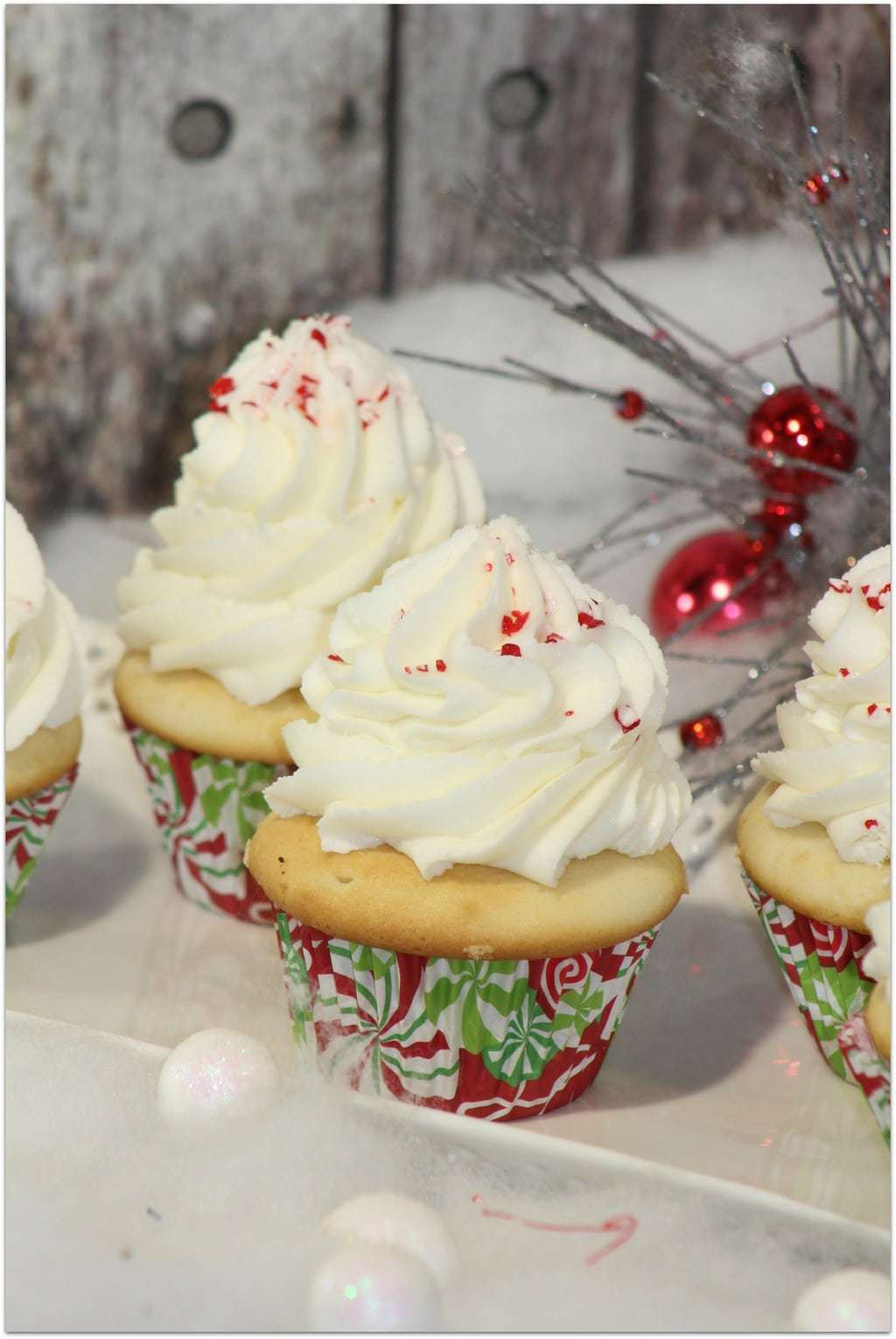 Who wants a Christmas cupcake? I've told you before that cupcakes are one of my favorite desserts for parties and celebrations, especially when kids are involved. This is an easy dessert recipe, but the result is just beautiful! As I always say, don't buy cupcakes when you can DIY! Want to be able to produce a beautiful topping of frosting like you see here? My secret is the Wilton Frosting gun! You won't believe how easy it is to produce professional looking desserts!