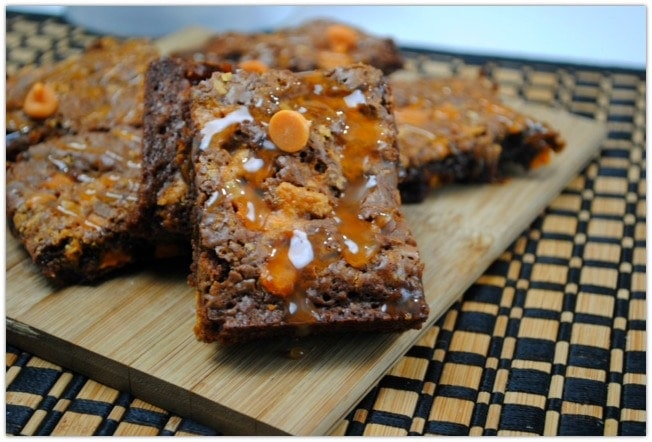 Everyone loves brownies, and these Butterfinger Brownies are the bomb! This dessert will be a hit at any party, and it's such an easy recipe! Using Ghirardelli dark baking chocolate and caramel chips along with Butterfinger bits takes this recipes to a whole new level. This will be your go-to dessert from now on!