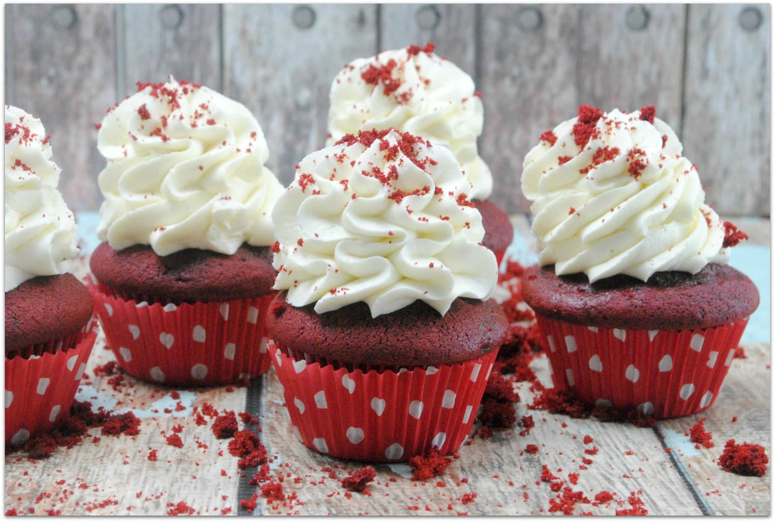 This classic red velvet cupcake recipe is the deliciousness of red velvet cake in a smaller portion, perfect for a party! One thing I love about cupcakes is that you don't need a plate and fork. When I'm bringing a dessert to a party or school event, I don't want to have to mess with bringing plates and forks, too. Everyone will love this decadent dessert recipe, and you will love that it's easy! No one wants to be in the kitchen for hours, including me!