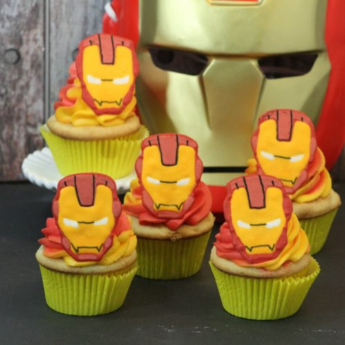Iron Man Cupcakes with Iron Man Mask in background.