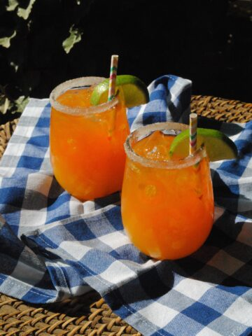 This refreshing Mango Margarita is the perfect drink to enjoy with friends. Festive enough for an elegant evening gathering, but easy enough for a drink by the pool, this cocktail will be your new favorite. All you need is a little food like chips and salsa and a few appetizers, good music, and you've got a summer party in the making!