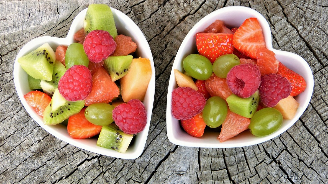Fruit in heart shaped white cups.