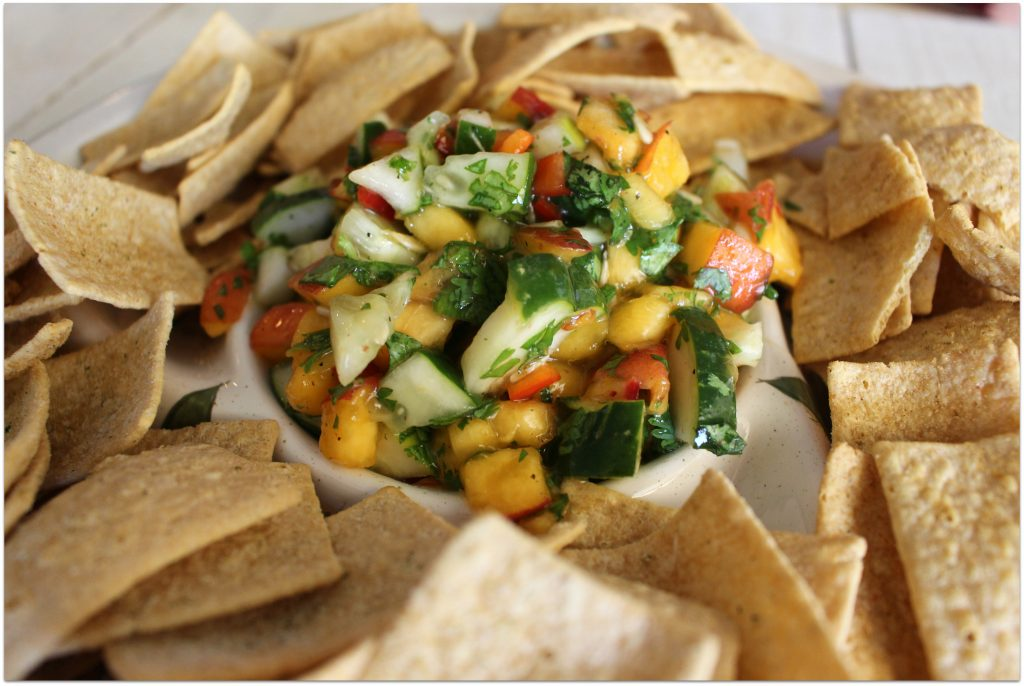 What could be better at a cookout or party than fresh peach and cucumber salsa? It doesn't matter what's on the table, I gravitate towards the chips and salsa. Any kind of salsa will do!