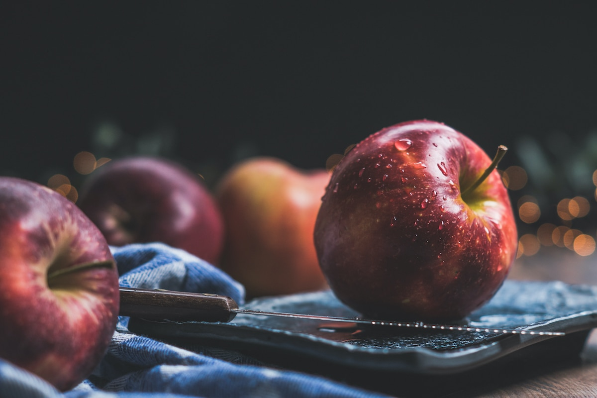 apples with a dark background on a blue cloth