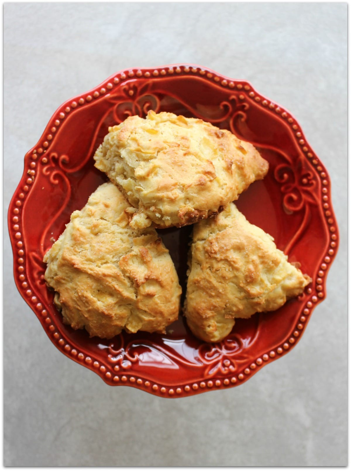 Scones on a red plate.