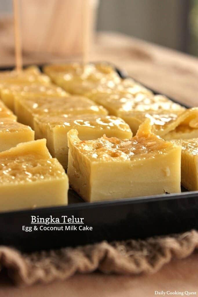 Bingka Telur Indonesian dessert on a black platter.