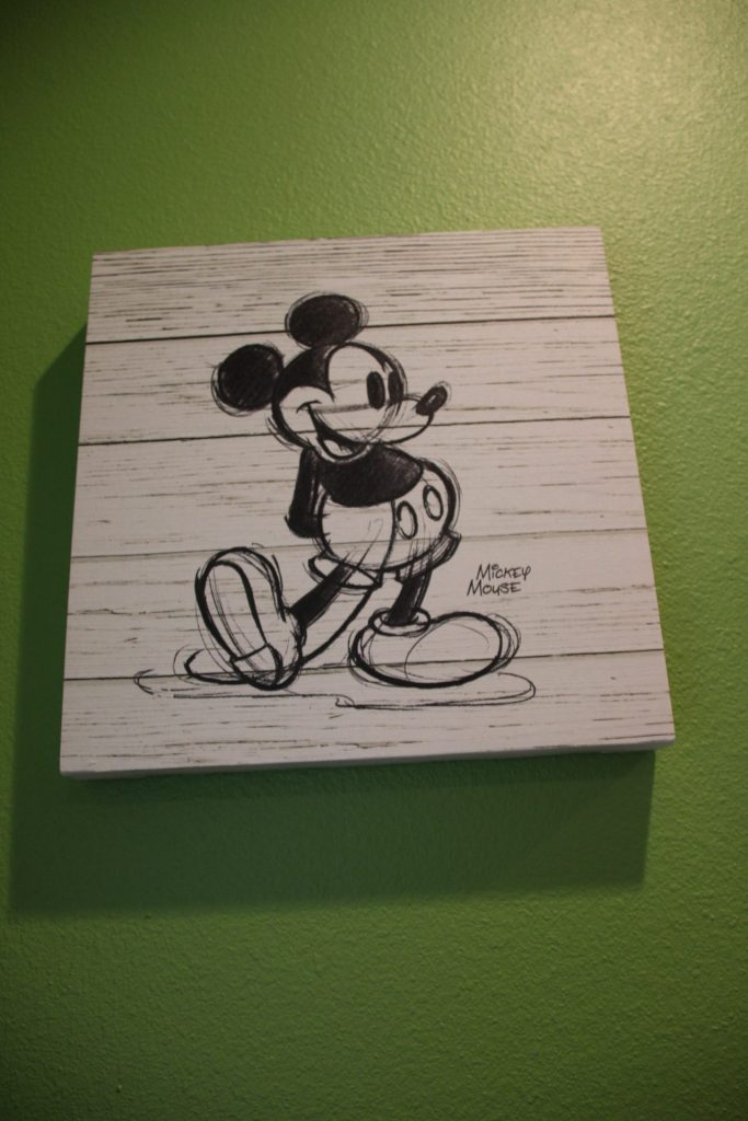when we built an addition on our home a few years ago, I thought it would be fun to decorate with Disney-themed movie art