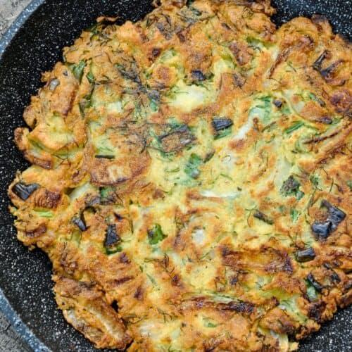 No egg omelet in a skillet.
