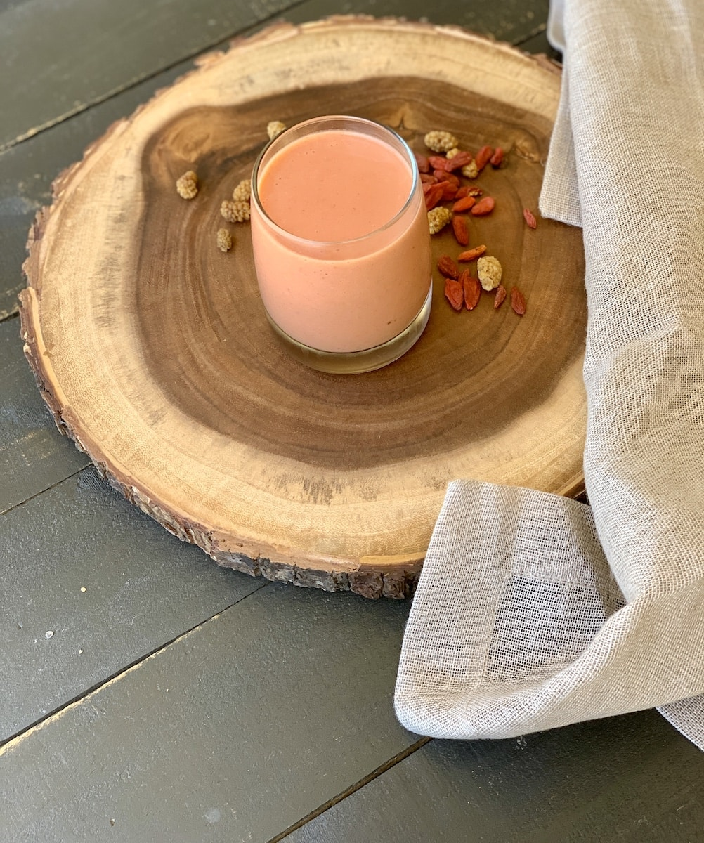 pink smoothie on a wood board