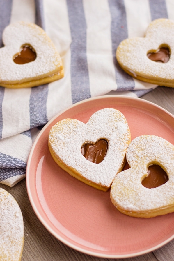 These Valentine's Day cookies are the perfect way to celebrate the holiday with your family. When my kids were little, I made cookies for Valentine's Day every year.