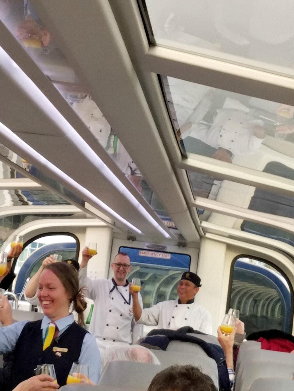 People celebrating on train.