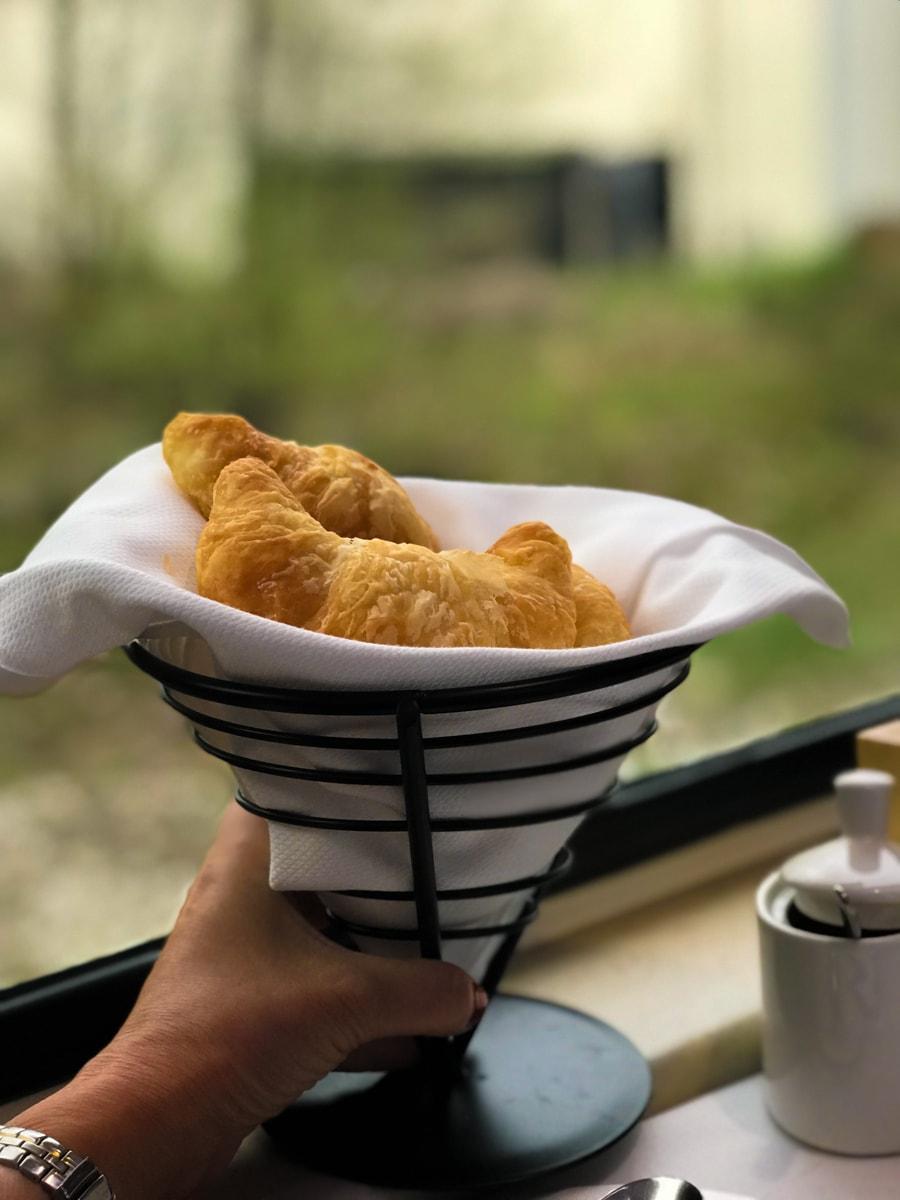 Basket of croissants in window of Rocky Mountaineer Train.